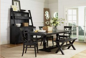 Black wooden furniture for a dining room; a charming and warm atmosphere